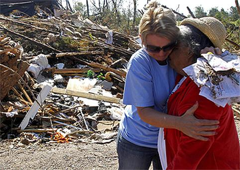 Nenia Cagle, left, consoles Annie Muse after a devastating tornado rips through Argo, Alabama
