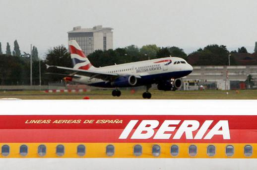British Airways and merger partner Iberia posted smaller losses today in the pair's first set of results since joining forces in January. Photo: PA