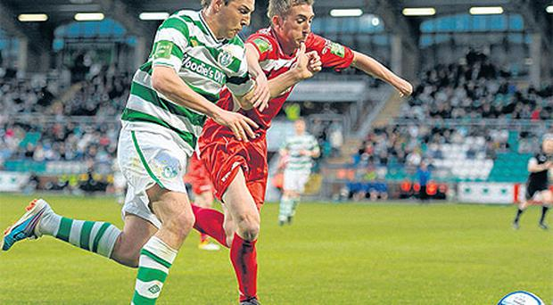 Karl Sheppard and Iarfhlaith Davoren battle it out at Tallaght