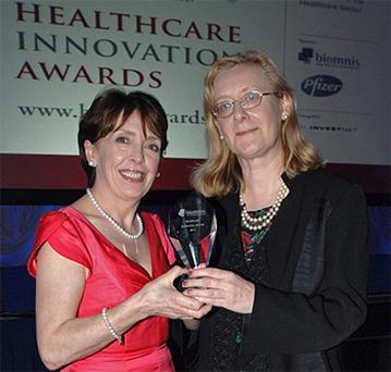 Eilish O'Regan accepting her award from Roisin Shortall