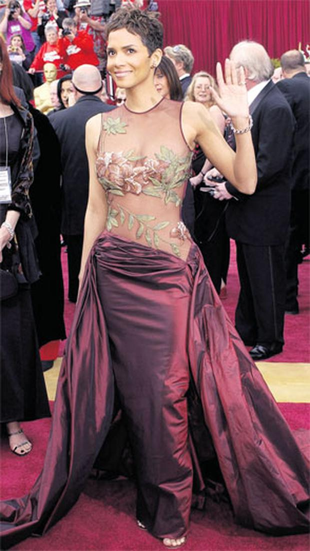 BEAUTIFUL IN BURGUNDY: Actress Halle Berry, wearing a dress designed by Elie Saab, at the Academy Awards show in 2002, before receiving her Oscar. Photo: Laura Rauch