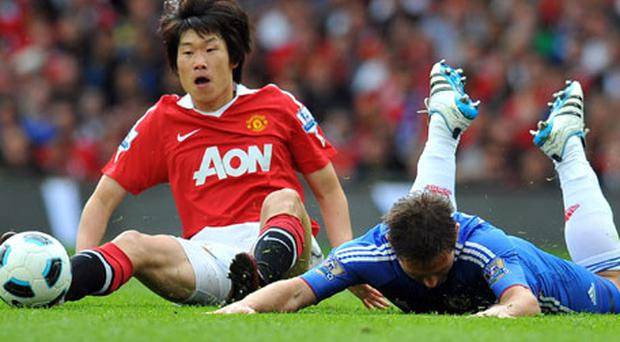 Manchester United's Park Ji-Sung tackles Frank Lampard during his team's victory over Chelsea at Old Trafford yesterday. Photo: Getty Images