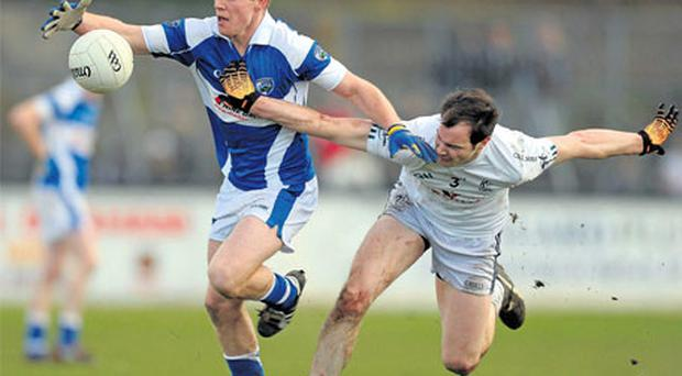 Laois' Darren Strong and Kildare's Michael Foley during their league clash. Both counties will head into the Championship with reasons to be hopeful.