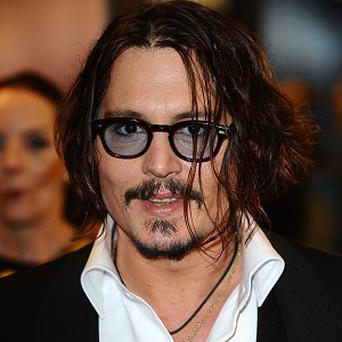Johnny Depp wants to wait a bit before making the fifth Pirates film