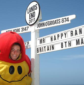 Andy Jackson, dressed as Mr Happy, has completed a 1,000-mile run from John O'Groats to Lands' End