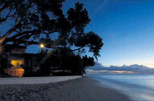 The sun sets over the Caribbean at Treasure Beach Hotel, where Eleanor stayed, in Paynes Bay, Barbados