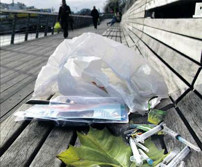 Drugs paraphernalia - including potentially deadly syringes - lie on a bench along the boardwalk, just yards from the GPO on O'Connell St