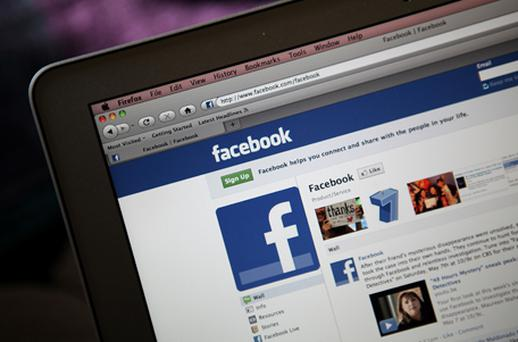 The Facebook website is displayed on a laptop computer on May 9 in San Anselmo, California. An investigation by The Pew Research Centre found that Facebook has become a player in the news industry as the popular social media site is driving an increasing amount of traffic to news web sites. Photo: Getty Images