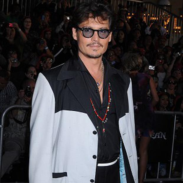Johnny Depp reckons seeing co-star Penelope Cruz with her new baby made him broody