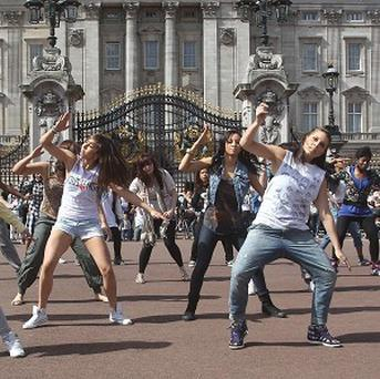 Students from the University of East London join a dance flashmob outside Buckingham Palace