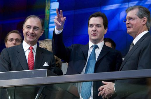 UK Chancellor of the Exchequer George Osborne is joined by Chris Gibson-Smith, LSE Group Chairman (right), Chief Executive Xavier Rolet (left) as he launches the London Stock Exchange Group's new opening bell. Photo: PA