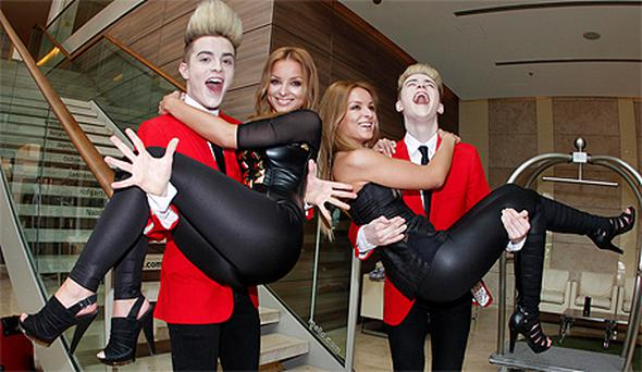 John and Edward Grimes hang out with twins Daniela and Veronika Nizlova from Slovakia in Dusseldorf yesterday