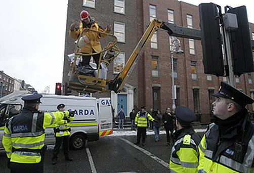 The scene outside Leinster House last December after 'Anglo Avenger' Joe McNamara parked a cherrypicker on the street