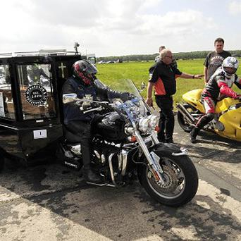 'Heaven's angel' the Rev Ray Biddiss clocked up 114mph driving a motorcycle hearse down an airport runway