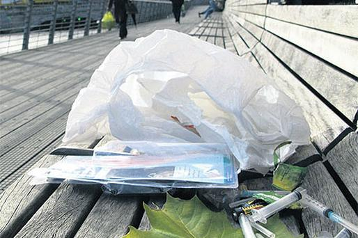 Needles used by drug addicts are discarded on the boardwalk in Dublin city centre