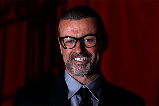 George Michael arrives at The Royal Opera House in London yesterday to announce details of a new tour which includes a date at the 02 Arena in Dublin next November