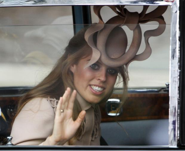 LONDON, ENGLAND - APRIL 29: Princess Beatrice of York arrives to attend the Royal Wedding of Prince William to Catherine Middleton at Westminster Abbey on April 29, 2011 in London, England. The marriage of the second in line to the British throne is to be led by the Archbishop of Canterbury and will be attended by 1900 guests, including foreign Royal family members and heads of state. Thousands of well-wishers from around the world have also flocked to London to witness the spectacle and pageantry of the Royal Wedding. (Photo by Dan Kitwood/Getty Images)