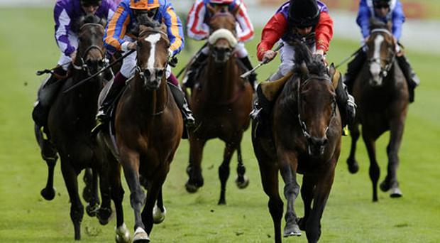 Ryan Moore guides Carlton House (right) to victory ahead of Aidan O'Brien's Seville in yesterday's Dante Stakes at York. Photo: Getty Images