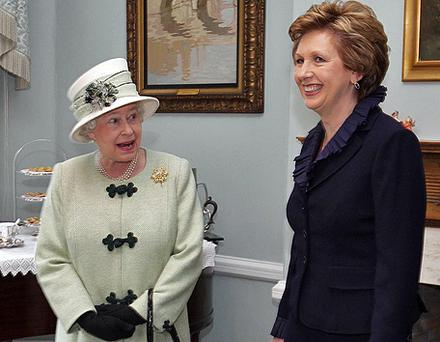 President Mary McAleese shares a joke with the queen at a luncheon to celebrate the centenary of Queen's University, Belfast, in April 2008