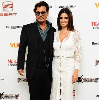 Johnny Depp and Penelope Cruz arrive for the UK premiere of Pirates of the Caribbean: On Stranger Tides