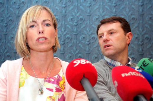 Kate McCann with her husband Gerry as she reads from 'Madeleine' at the launch of the book, pictured right, in Dublin's Merrion Hotel yesterday. Photo: FRANK McGRATH