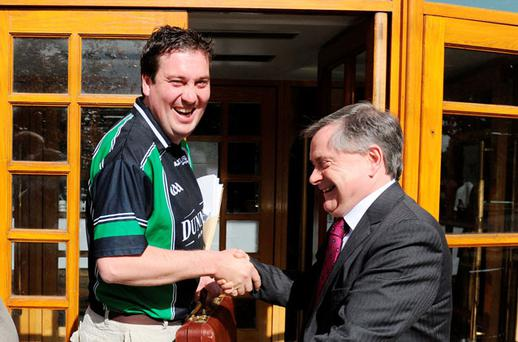 Joe Deegan, from Stradbally, welcomes Public Expenditure and Reform Minister Brendan Howlin at the IMPACT conference in Tralee, Co Kerry, yesterday.