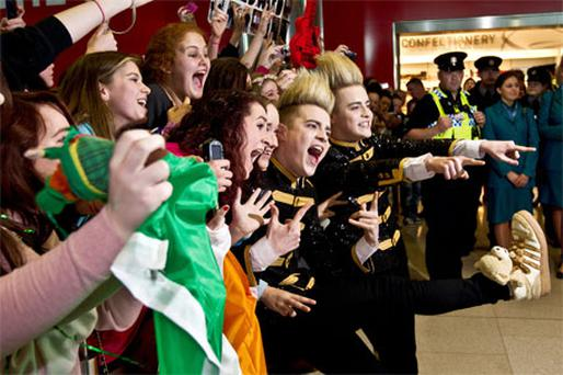 John and Edward Grimes pose with fans at Dublin airport yesterday, where they were given an official escort on their arrival from Germany