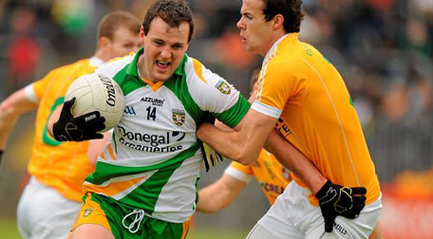 Antrim's Richard Johnston grapples with Donegal's Michael Murphy during their Ulster SFC clash in Ballybofey yesterday. Photo: Oliver McVeigh / Sportsfile