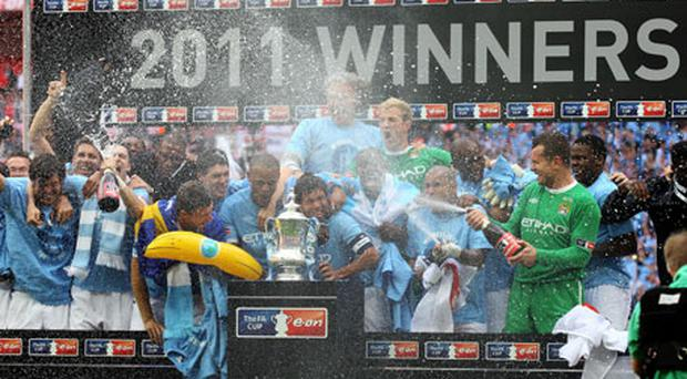 Manchester City players including Ireland's Shay Given (far right) celebrate winning the FA Cup at Wembley on Saturday. Photo: Getty Images
