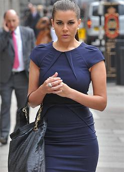 Imogen Thomas leaving the Royal Courts of Justice today. Photo: AP