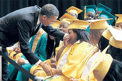 Barack Obama greets an emotional student from Booker T Washington High School in Memphis, Tennessee, at the school's graduation yesterday