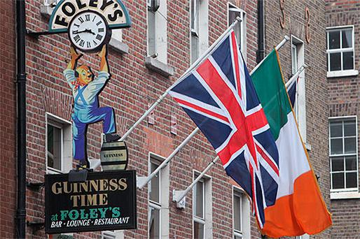 Union Jack and Irish Tricolour flags outside Foley's pub on Baggot Street, Dublin, yesterday