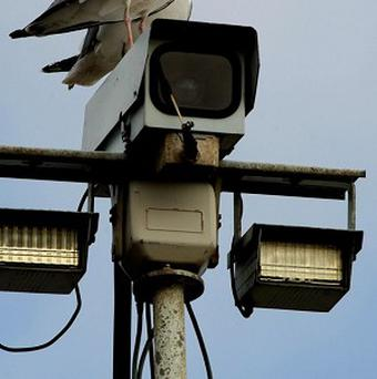 Vandals have used a portable saw to cut down a CCTV camera pole