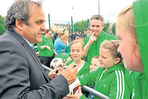 Former French international Michel Platini signs autographs for children at the 2011 UEFA Europa League final grassroots tournament in Dublin yesterday