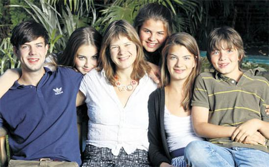 Balanced approach: Cassandra Jardine (second from left) with children Oliver, Eliza, Cassandra, Dido, Christabel and George.