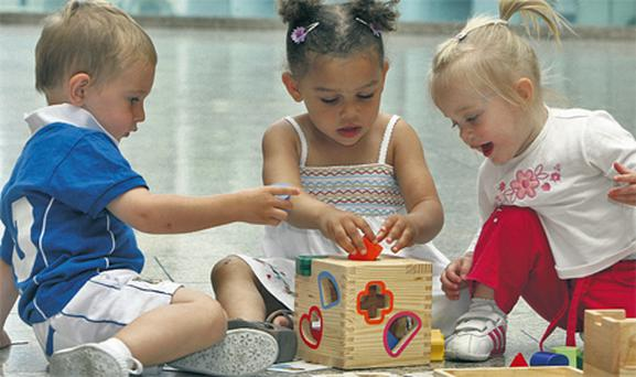 Children from Little Treasures Community Creche, North Wall, Dublin (part of the Early Learning Initiative) play together at sorting blocks