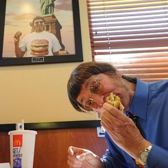 Don Gorske enjoys the 25,000th Big Mac of his life (AP)