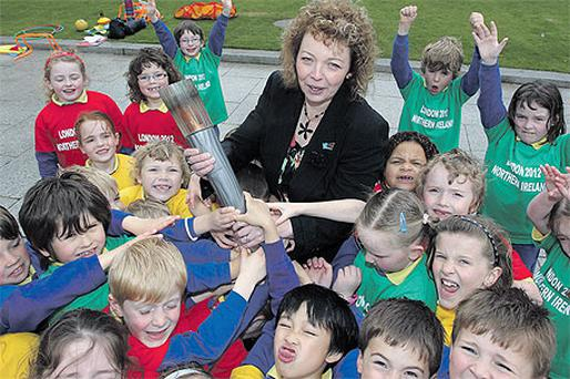 The North's minister for culture Caral Ni Chuilin with Belfast schoolchildren and the Olympic Torch