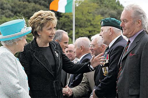 President Mary McAleese introduces Kevin Myers to Queen Elizabeth during a tour of the Irish War Memorial Garden in Islandbridge, Dublin, yesterday