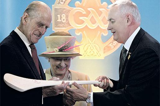 GAA president Christy Cooney presenting Queen Elizabeth and Prince Philip with a hurley and sliotar at Croke Park, Dublin, yesterday