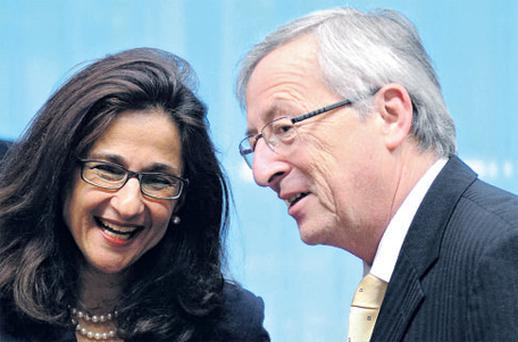 IMF deputy managing director Nemat Shafik talking with the president of the Eurogroup Jean Claude Juncker at the ecofin meeting at the EU Council in Brussels