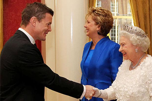 Britain's Queen Elizabeth and Ireland's President Mary McAleese (C) greet Ireland's rugby team captain Brian O'Driscoll when she visited Ireland in 2011. Photo: Reuters