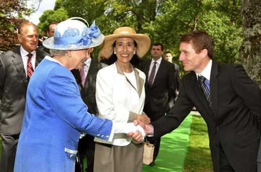 Queen Elizabeth II shakes hands with Jonny Murtagh during a visit to the Irish National Stud, one of the country's top horsebreeding centres, near Dublin, Co Kildare. Photo: PA