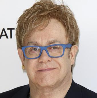 Sir Elton John has visited 10 Downing Street to talk with David Cameron about the work of his Aids Foundation