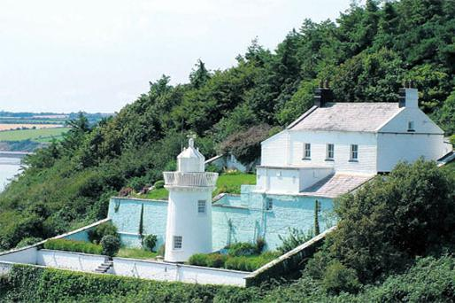 Light up your home: A 19th-century cottage and lighthouse in Duncannon Harbour, Co. Wexford, which goes for auction on June 17.