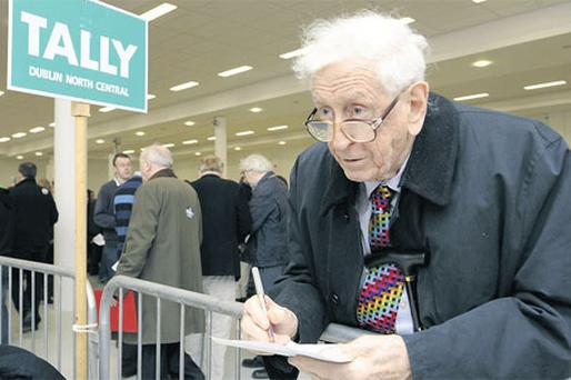 Former Taoiseach Garret FitzGerald keeps an eye on the Dublin North Central constituency at the 2011 count centre in the RDS
