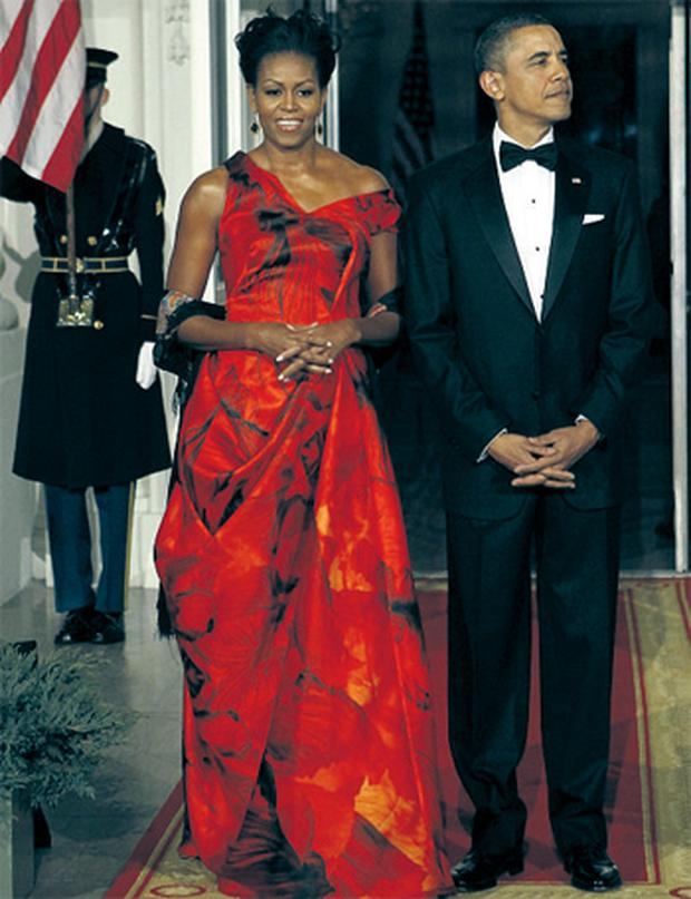 Michelle Obama's gown for a state dinner for President Hu Jintao of China was a red silk organza dress, with a streaky print of black petals. The full-skirted dress was designed by Sarah Burton of Alexander McQueen