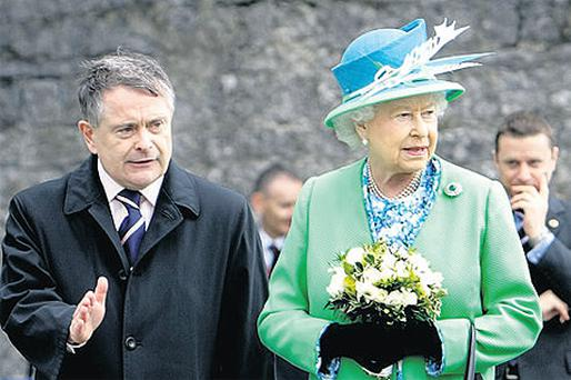 Queen Elizabeth with Minister for Public Expenditure Brendan Howlin in Cashel yesterday