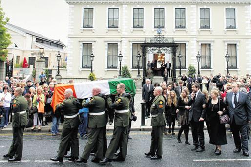 TRIBUTES: The remains of Garret FitzGerald carried from the Mansion House last night, as his children John, Mary and Mark and other family members follow. Photo: David Conachy