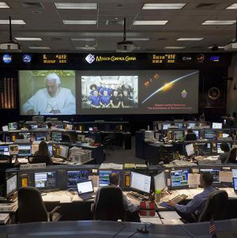 Video feeds at Johnson Space Centre show the Pope talking with astronauts (AP/Houston Chronicle)